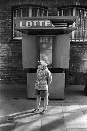 A girl waits. Wismar, GDR, 1984